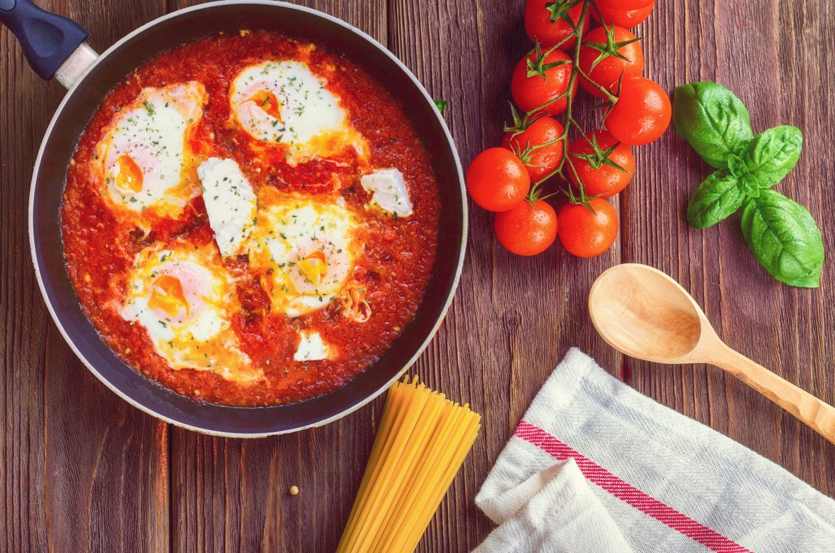 Greek Shakshuka on a Wooden Board