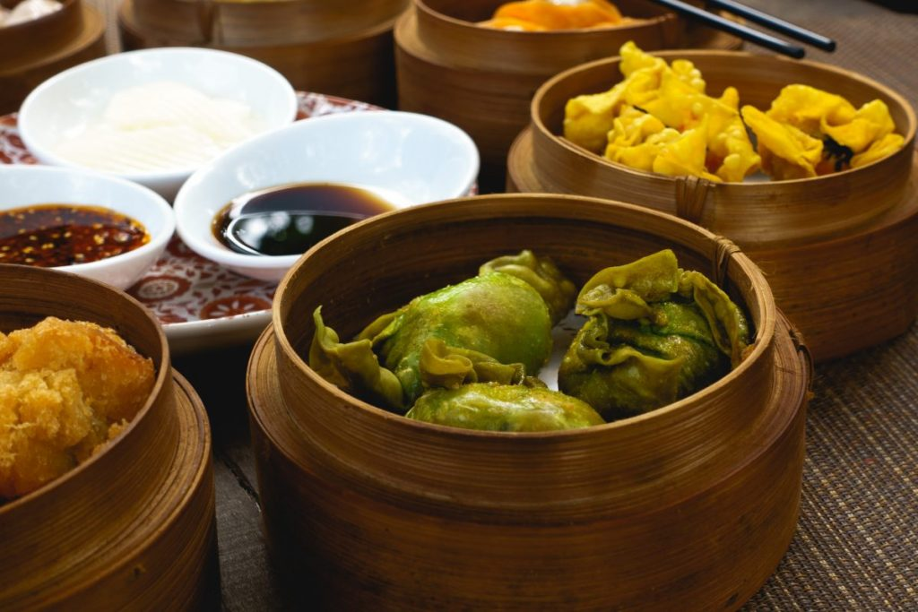 Chinese fried dim sum in wooden steamers