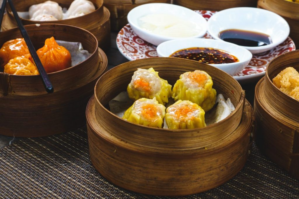 Chinese steamed and fried dim sum in wooden steamers