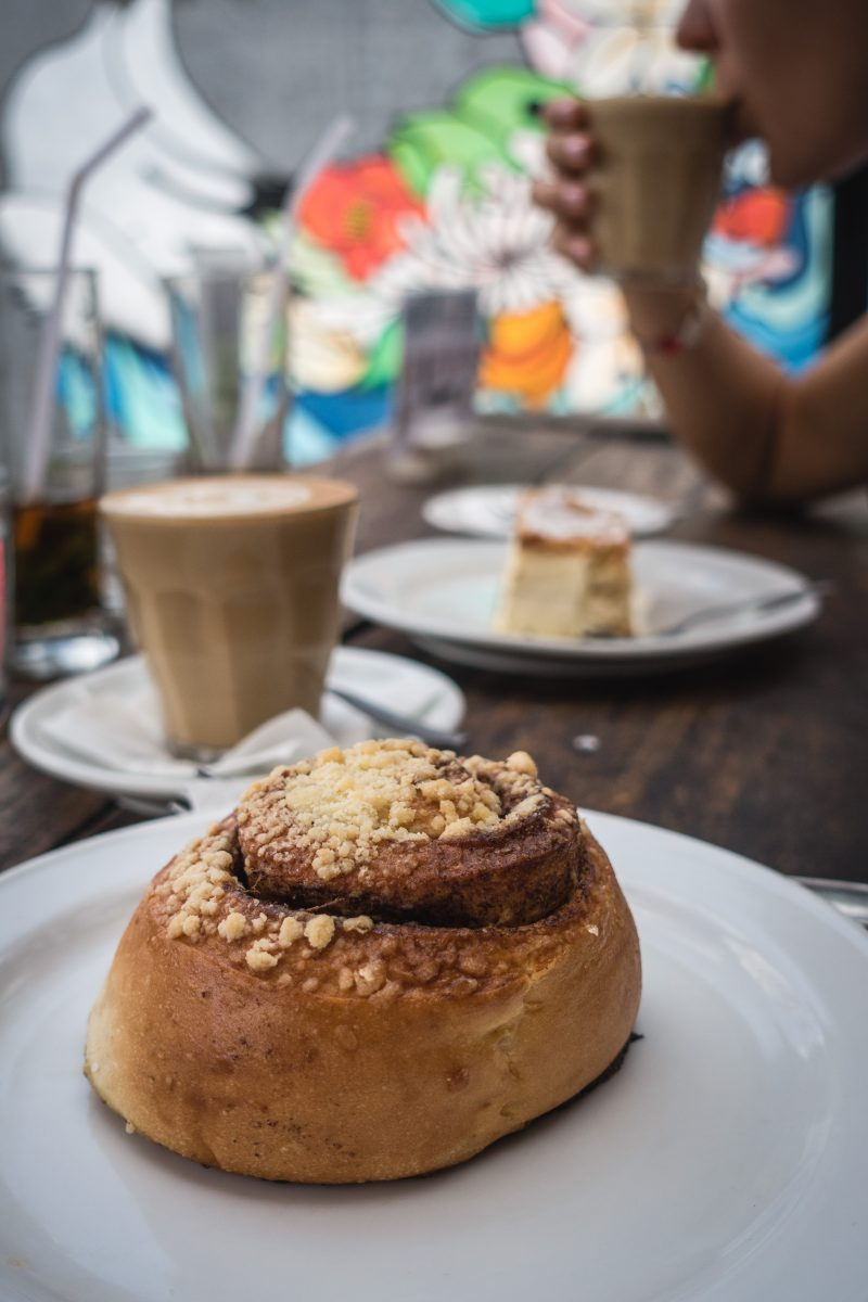 Cinnamon roll with coffee in a coffeeshop