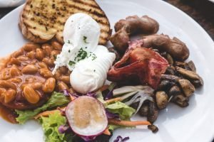High protein brunch with poached eggs, beans and bacon