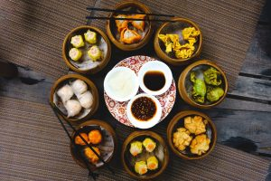 Vibrant shot of feasting on chinese steamed and fried dim sum