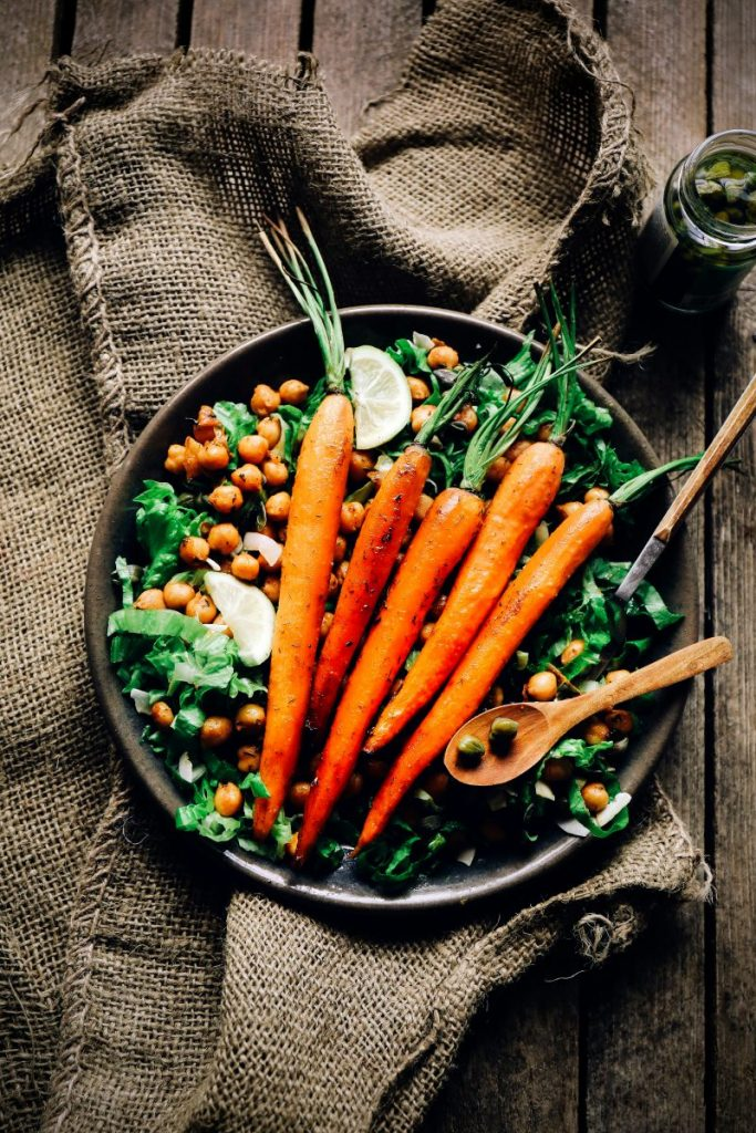 Baked carrots on a chickpeas salad