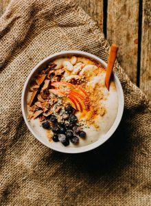 Banana oatmeal with blueberries, chocolate and apple