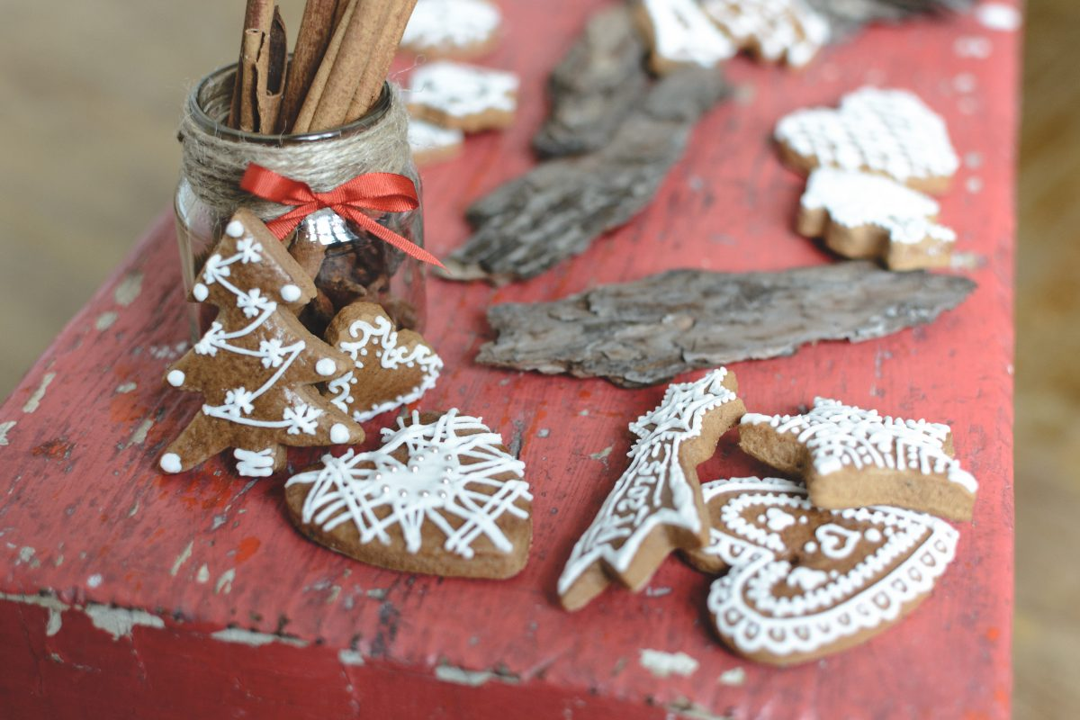 Bunch of traditional Christmas gingerbread on red wood
