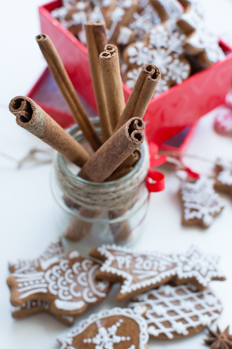 Dried cinnamon with a bunch of Christmas gingerbreads