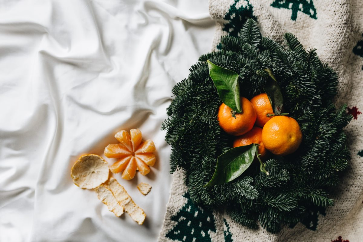Tangerines on a simple natural Christmas wreath
