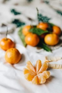 Tangerins with leaves on a white linen