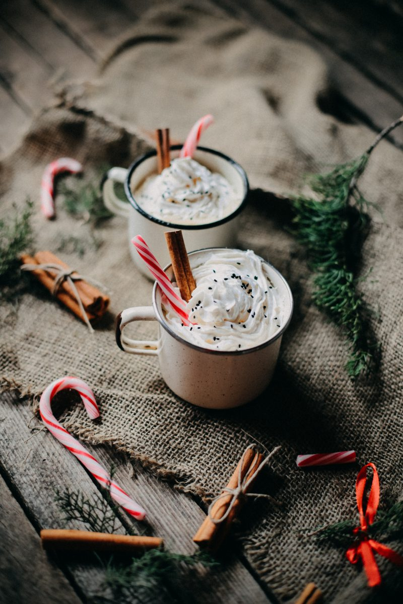 Hot chocolate with cream and dried cinnamon