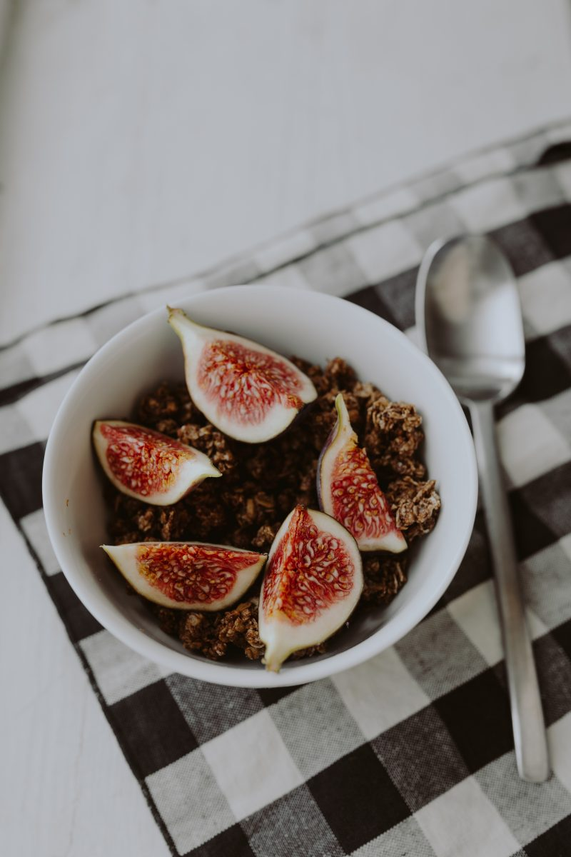 Bowl of crunchy granola and figs