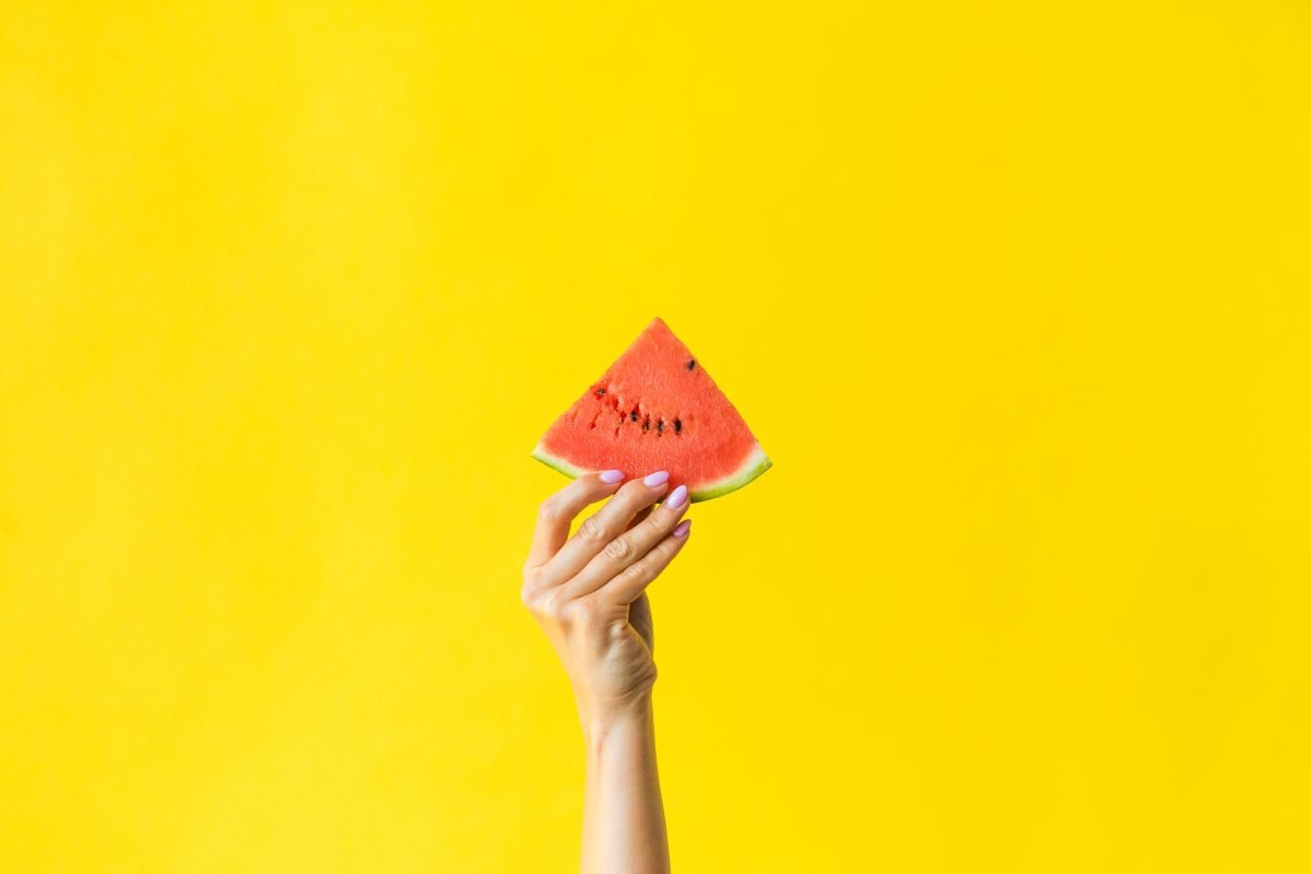 Bright slice of watermelon in a woman's hand