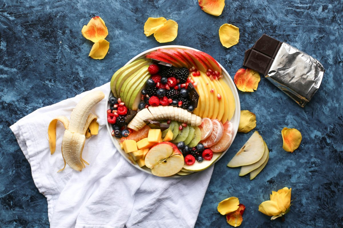 Colorful fruit platter and dark chocolate