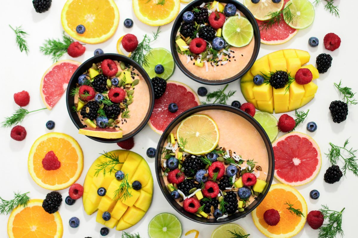 Colorful smoothies with fresh fruits
