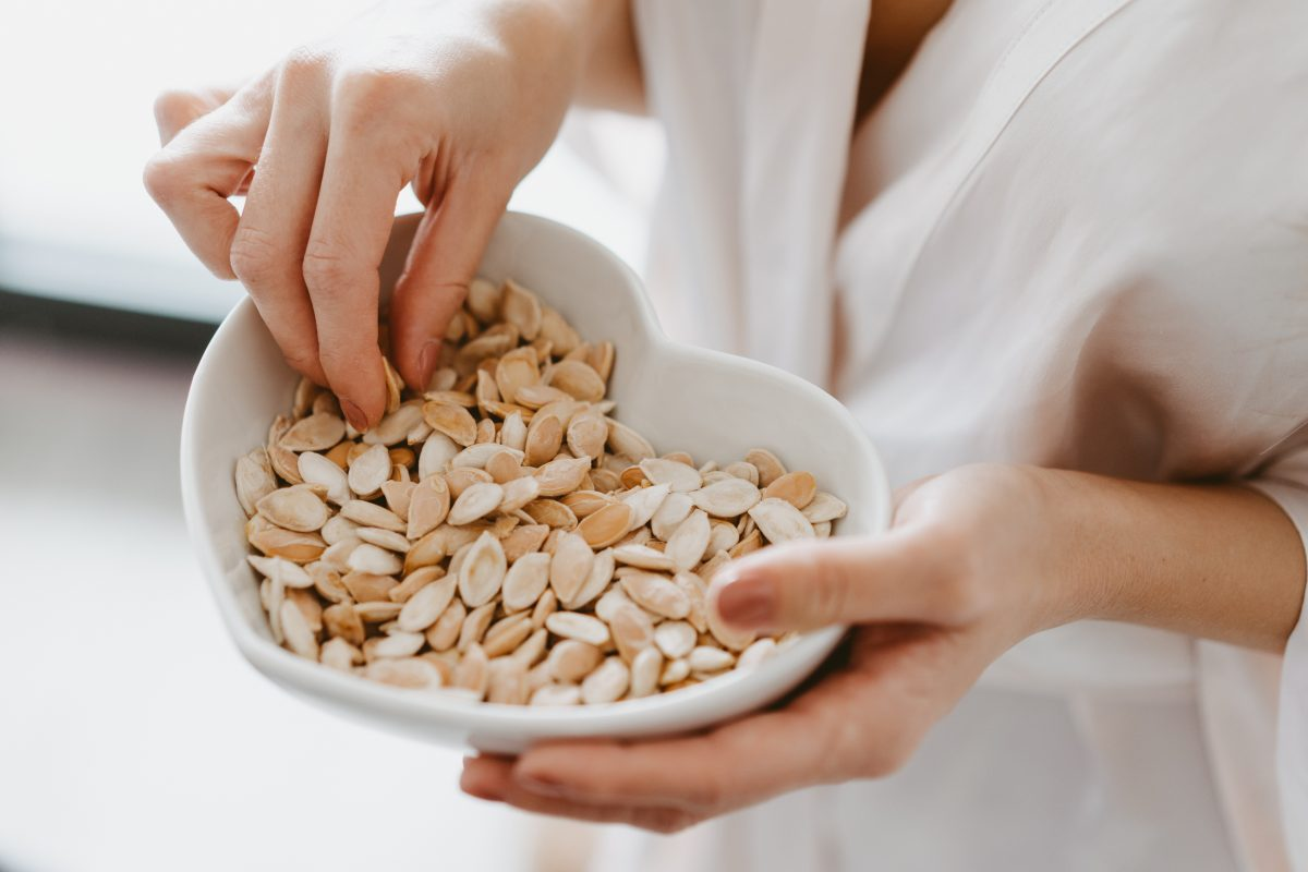 Woman eating roasted pumpkin seeds