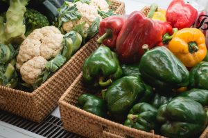 Bell peppers and other fresh vegetables in a store