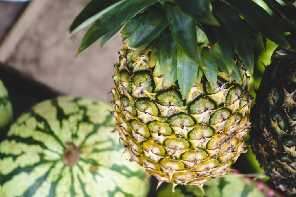 Fresh pineapple hanging at a market