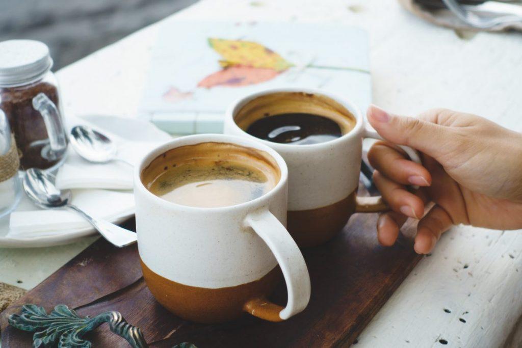 Having dark americano coffee outside