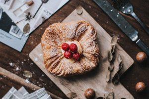 Sweet vanilla pastry with raspberries on top