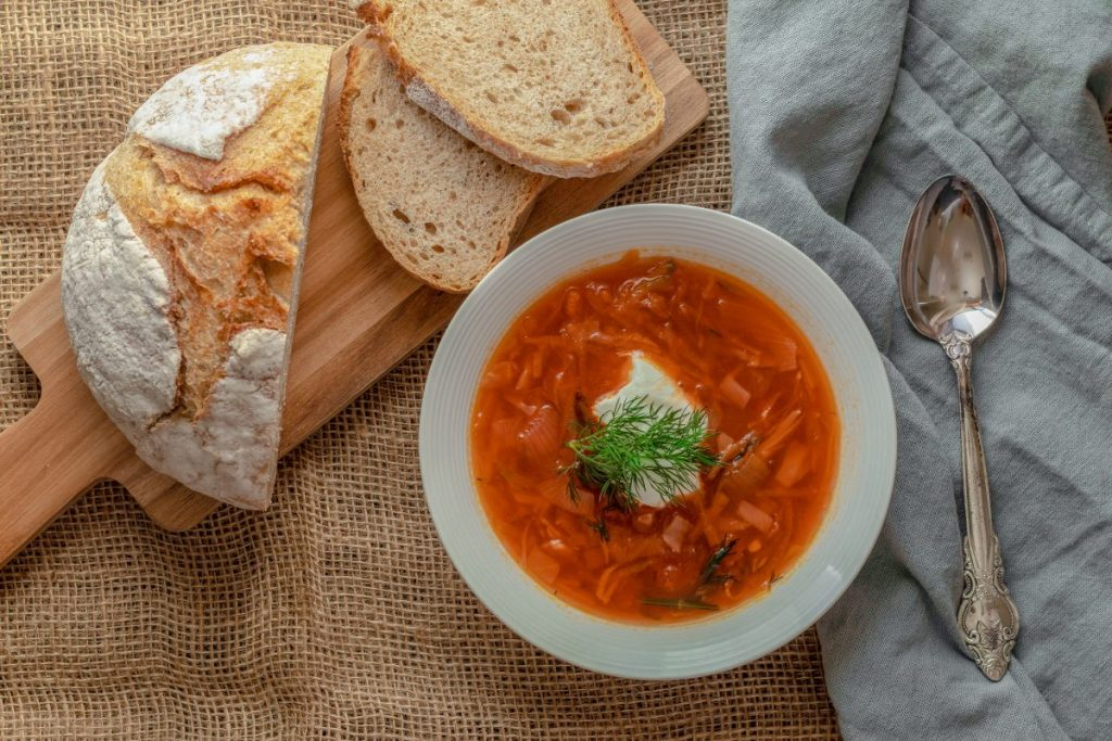 Beet root soup Borscht with bread