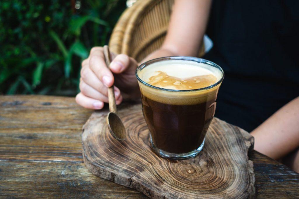Black coffee with coconut milk foam