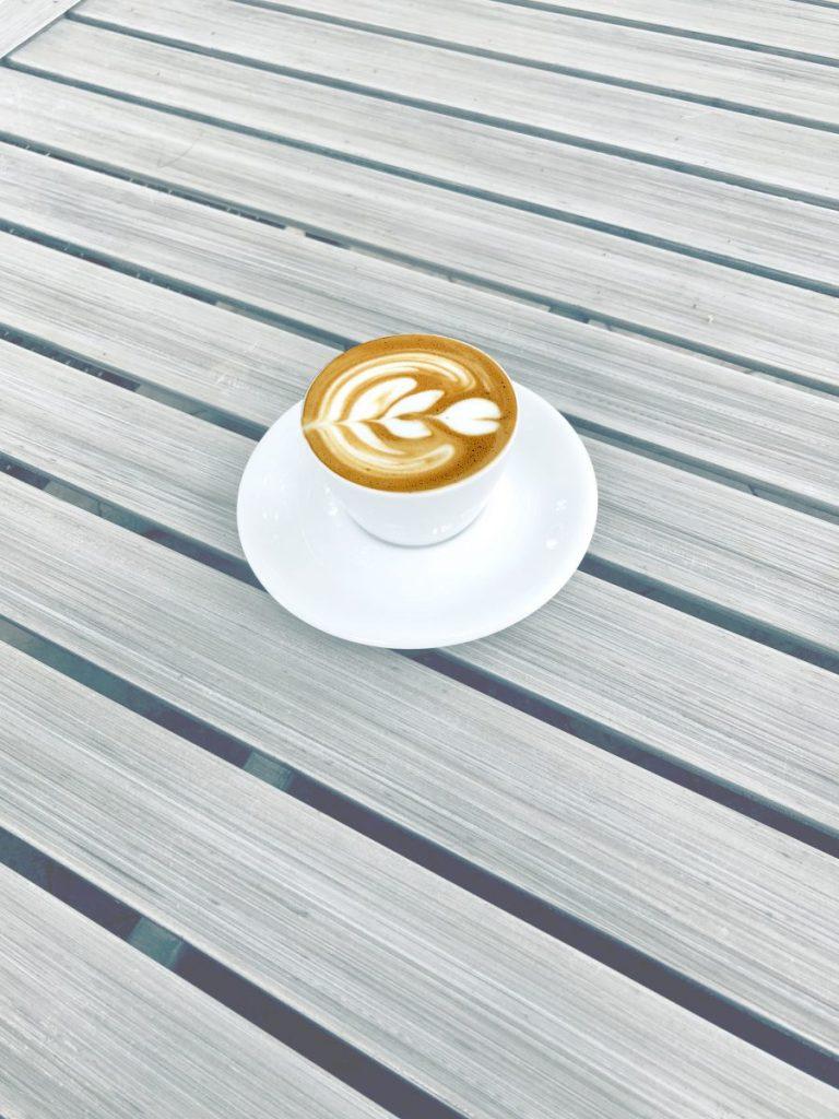 Morning espresso with flower latté art