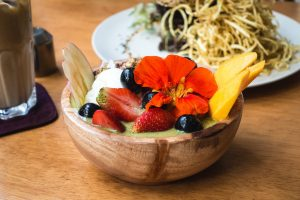 Colorful healthy smoothie bowl with fruits