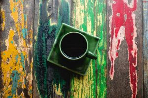Cup of coffee on a colorful table