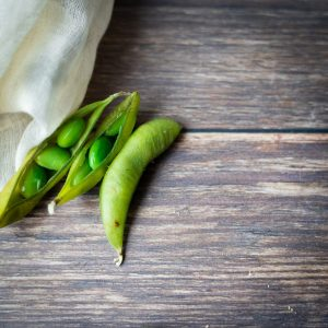 Fresh peas on a wooden background