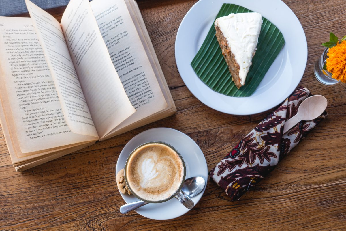 Relaxing with coffee, cake and book