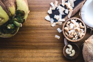 Cashew nuts and coconut on a wooden table