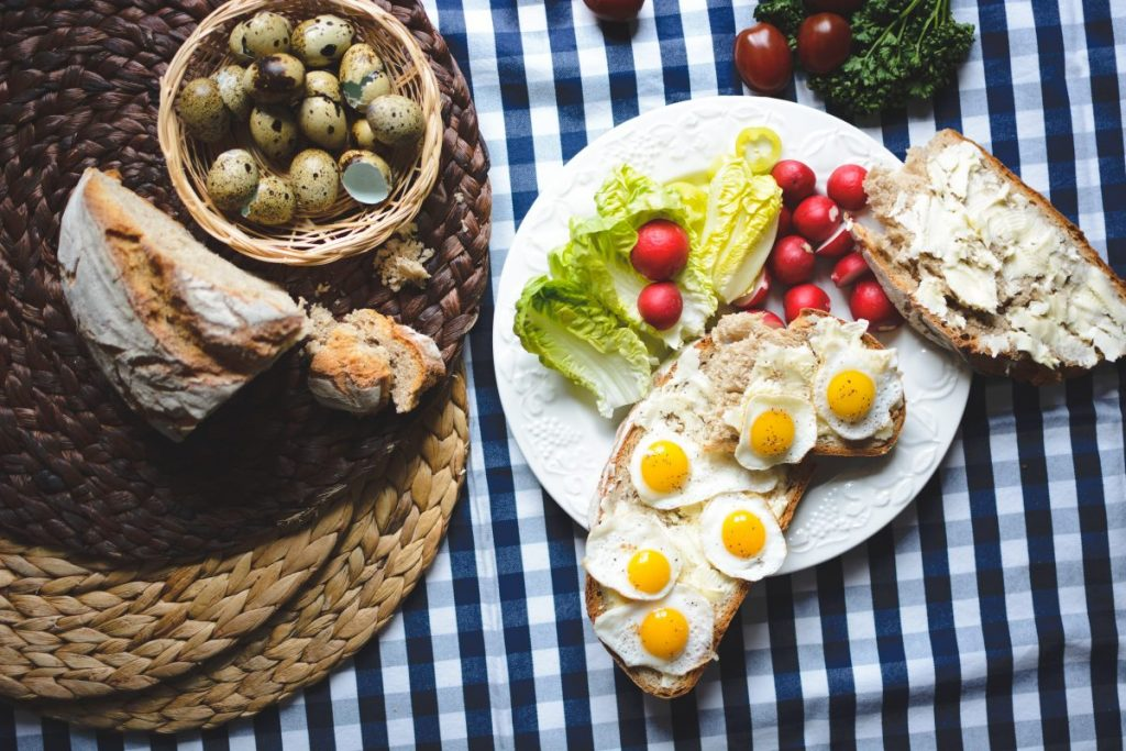 Easter breakfast of fried quail eggs on bread with butter