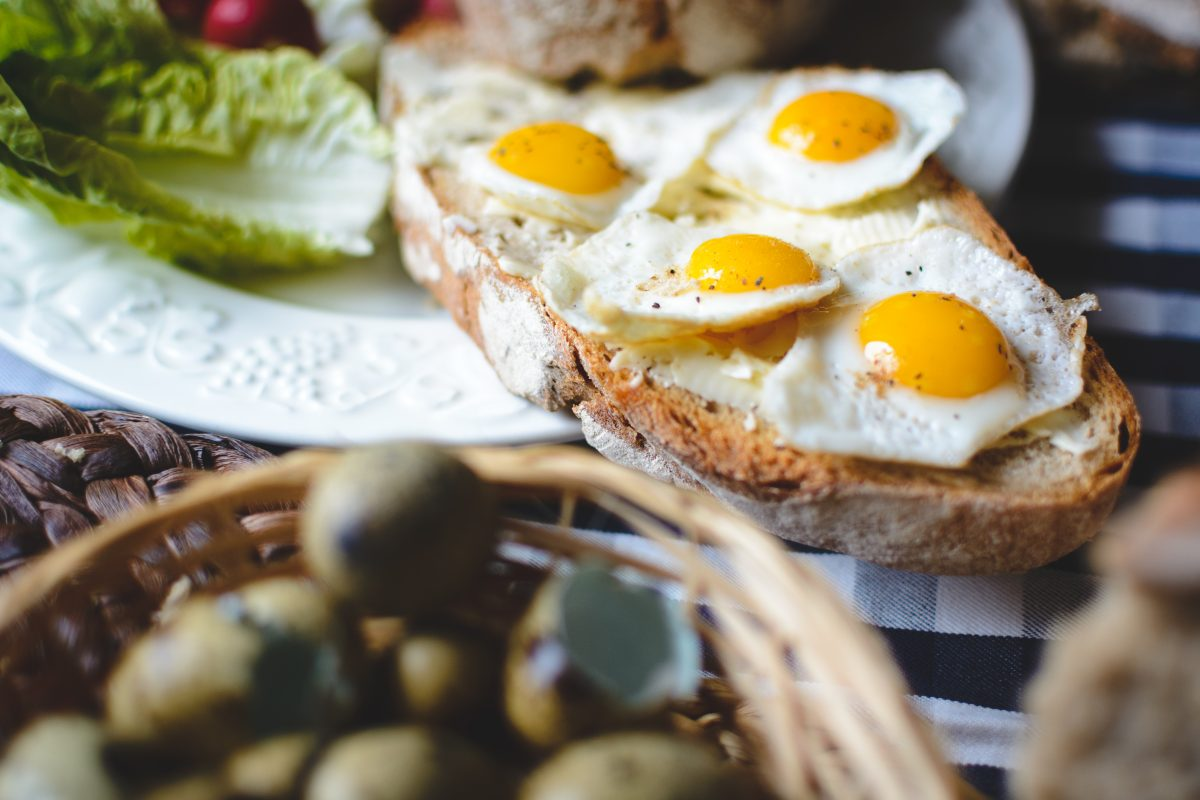 Fried quail eggs on bread with butter detail