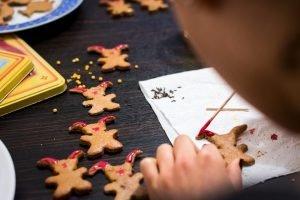Girl decorating easter gingerbread cookies