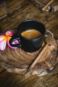 Small black cup with espresso coffee