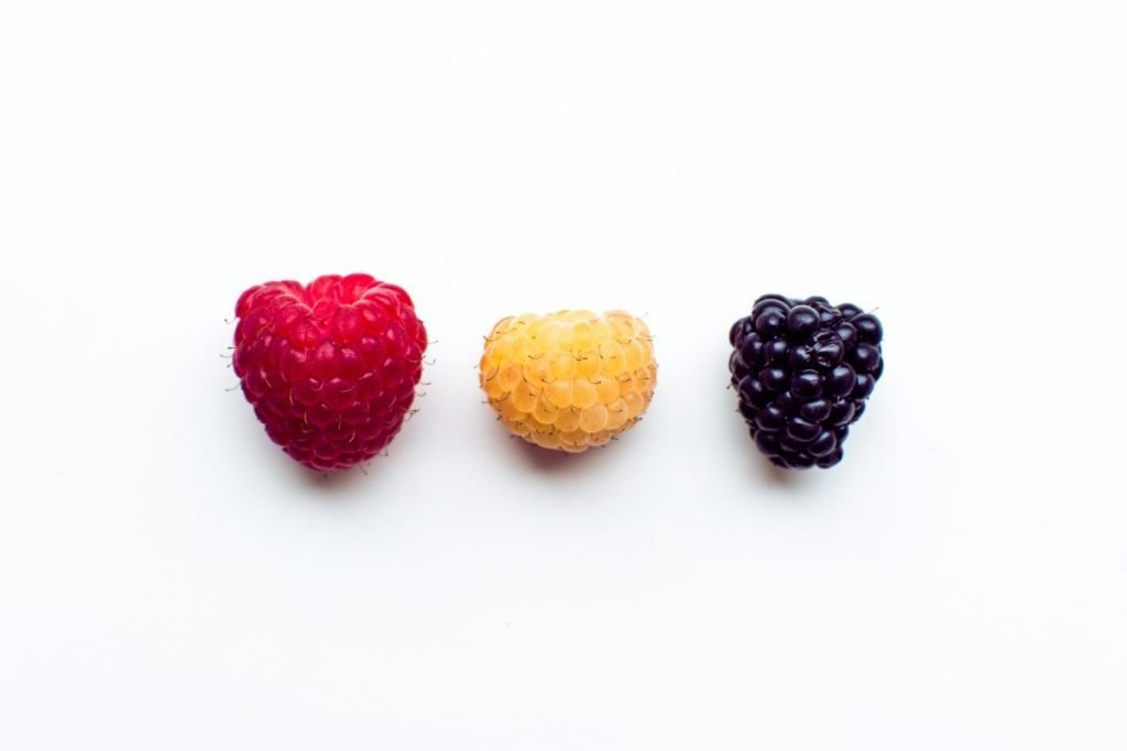 Colorful fresh berries on a white background