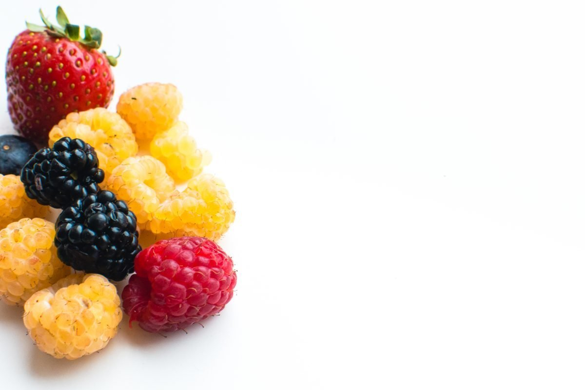 Detail of colorful healthy fresh berries on a white background