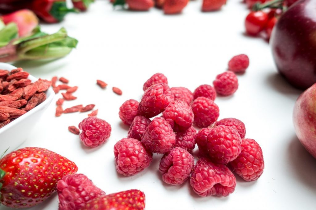 Fresh raspberries with other red fruit and vegetables