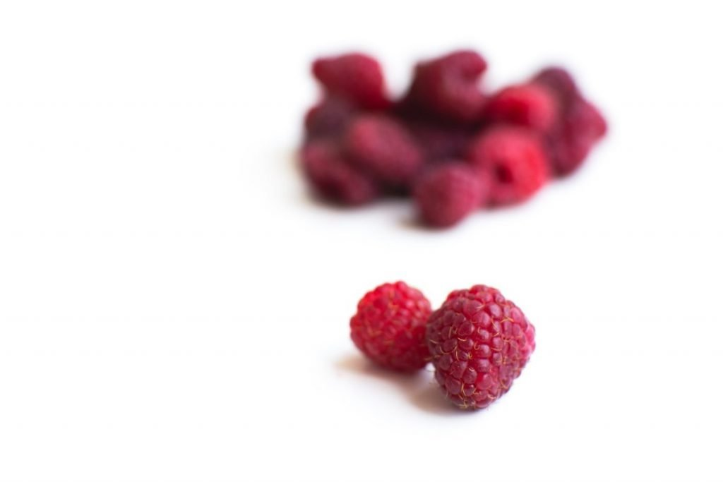 Raspberries on a white background
