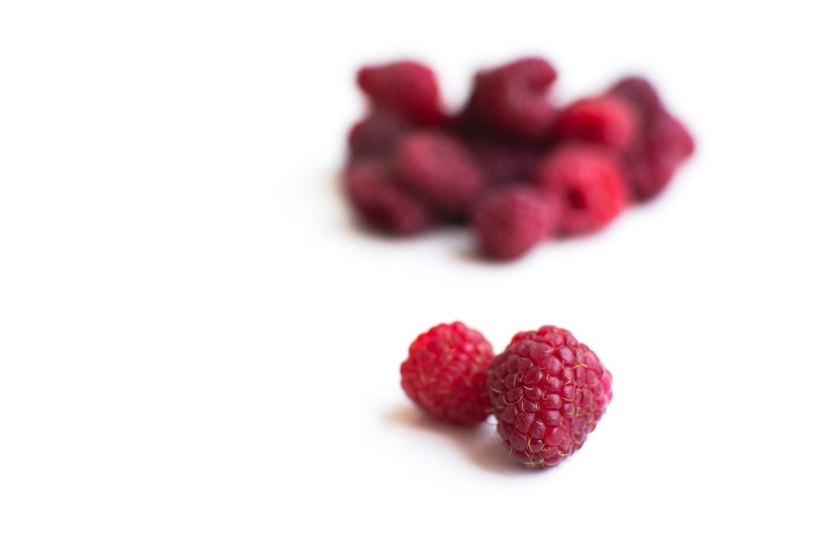 Raspberries on a white background