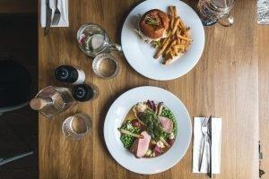 Dinning burger and grilled pork tenderloin in restaurant