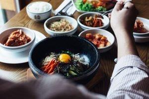 Eating Korean Bibimbap with chopsticks