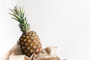 Fresh funky pineapple with a white background