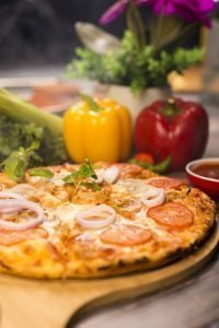 Simple pizza with onions and tomatoes