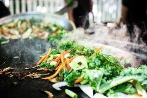 Grilling vegetables at street food market