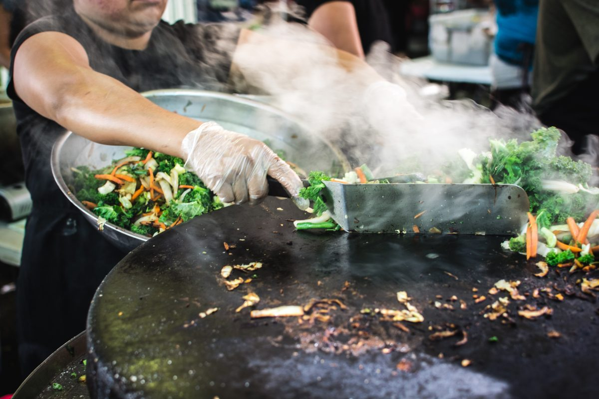 Grilling vegetables at street food market