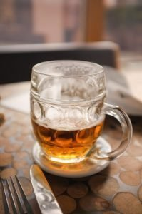 Half-full glass of beer