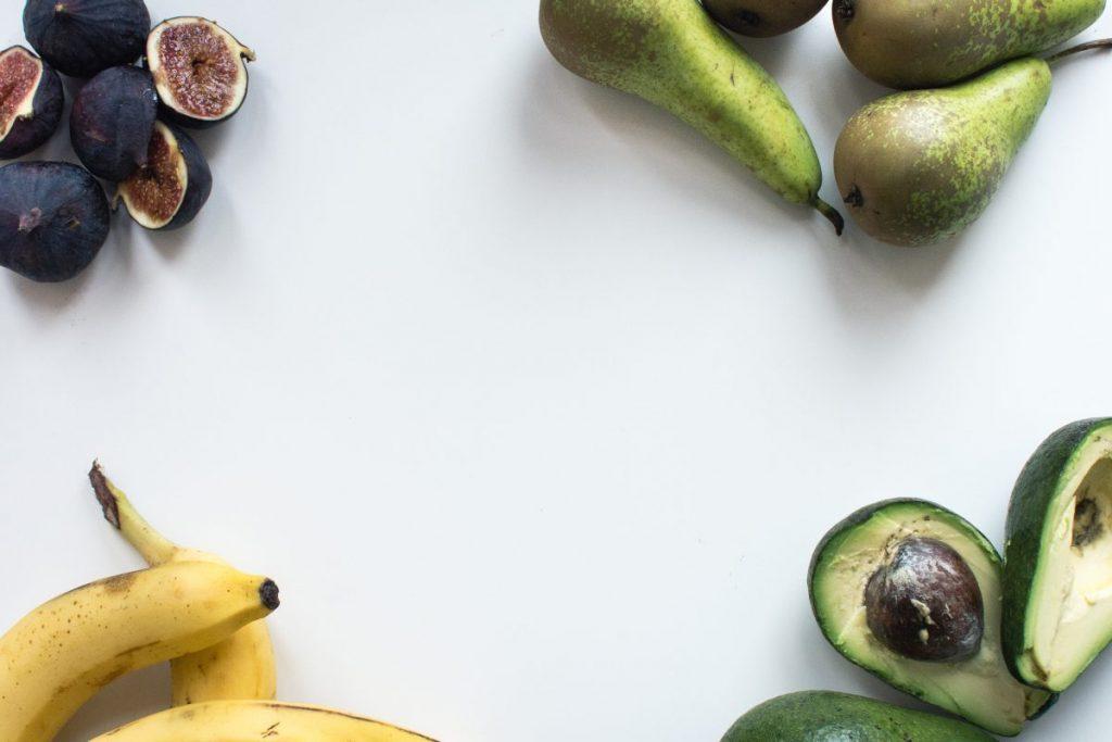 Aerial shot of fresh figs, bananas, pears and avocados