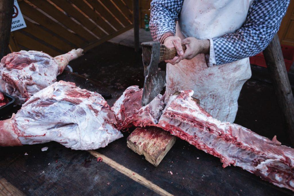 Butcher butchering a meat