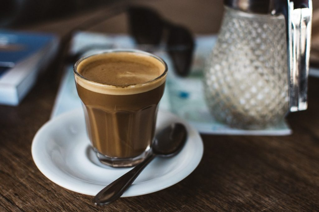 Coffee cortado in a glass cup