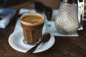 Coffee cortado in a glass cup